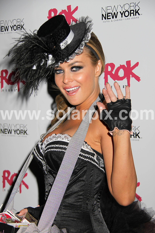 **ALL ROUND PICTURES FROM SOLARPIX.COM**.**SYNDICATION RIGHTS FOR UK, SPAIN, PORTUGAL, AUSTRALIA, S.AFRICA & DUBAI (U.A.E) ONLY**.Carmen Electra Vamps it Up at Rok Vegas, at the New York New York Hotel and Casino, Las Vegas, NV, USA. 31st October 2008..JOB REF: 7785 PHZ (PRN)   DATE: 31_10_2008.**MUST CREDIT SOLARPIX.COM OR DOUBLE FEE WILL BE CHARGED* *UNDER NO CIRCUMSTANCES IS THIS IMAGE TO BE REPRODUCED FOR ANY ONLINE EDITION WITHOUT PRIOR PERMISSION*