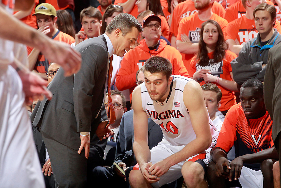 Virginia head coach Tony Bennett talks with Virginia forward/center Mike Tobey (10) during an NCAA basketball game Saturday Feb. 7, 2015, in Charlottesville, Va. Virginia defeated Louisville  52-47. (Photo/Andrew Shurtleff)