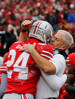 Ohio State Buckeyes kicker Drew Basil (24) embraces special teams coordinator and defensive back coach Kerry Combs during Senior Day celebration before the college football game between the Ohio State Buckeyes and the Indiana Hoosiers at Ohio Stadium in Columbus, Saturday afternoon, November 23, 2013. The Ohio State Buckeyes defeated the Indiana Hoosiers 42 - 14. (The Columbus Dispatch / Eamon Queeney)