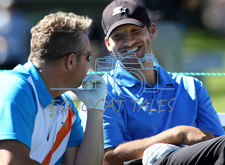 Rascal Flatts singer Gary Levox, left, talks with Dallas Cowboys quarterback Tony Romo during a practice round at the 22nd American Century Celebrity Golf Championship at Edgewood Tahoe Golf Course in Stateline, Nev., on Thursday, July 14, 2011. .Photo by Cathleen Allison