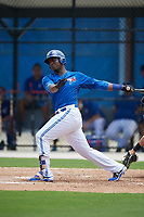 GCL Blue Jays first baseman Yhordegny Kelly (49) follows through on a swing during a game against the GCL Pirates on July 20, 2017 at Bobby Mattick Training Center at Englebert Complex in Dunedin, Florida.  GCL Pirates defeated the GCL Blue Jays 11-6 in eleven innings.  (Mike Janes/Four Seam Images)