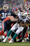17 December 2006: Miami Dolphins running back Sammy Morris (31) is brought down by Buffalo Bills defensive tackle Kyle Williams (95) at Ralph Wilson Stadium in Orchard Park, New York. The Bills defeated the Dolphins 21-0.. .Mandatory Photo Credit: Ed Wolfstein Photo<br />