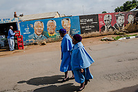 SOWETO, JOHANNESBURG, SOUTH AFRICA - DECEMBER 08: South Africans gather to pay respect and tribute to former President Nelson Mandela at the Regina Mundi Church in Soweto on December 8, 2013 in Johannesburg, South Africa. Mr Mandela, died on Thursday aged 95, spent 27 years in jail before becoming South Africa's first black president in 1994.<br /> Photo by Daniel Berehulak for The New York Times