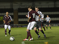 Jamie Walker closed down by Adam Brown in the St Mirren v Heart of Midlothian Clydesdale Bank Scottish Premier League U20 match played at St Mirren Park, Paisley on 6.11.12.