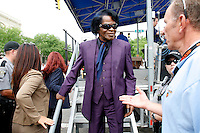 Singer James Brown walks off a stage after greeting the crowd assembled to watch the start of Stage 1 of the 2006 Ford Tour de Georgia pro cycling race. Brown lives close by in North Augusta, South Carolina. Lars Michaelsen of Team CSC won the 129-mile stage from Augusta to Macon in 4:45:46.<br />