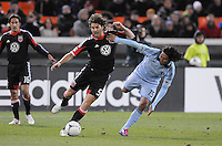 D.C. United defender Dejan Jakovic (5) shields the ball against Sporting Kansas City midfielder Roger Espinoza (15) Sporting Kansas City defeated D.C. United  1-0 at RFK Stadium, Saturday March 10, 2012.