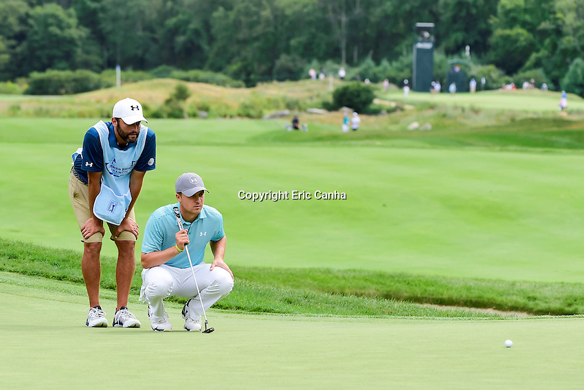 Saturday, September 3, 2016:  Jordan Spieth studies his putt with his caddy  Michael Greller on the on the seventh green during the second round of the Deutsche Bank Championship tournament held at the Tournament Players Club, in Norton, Massachusetts.  Eric Canha/Cal Sport Media