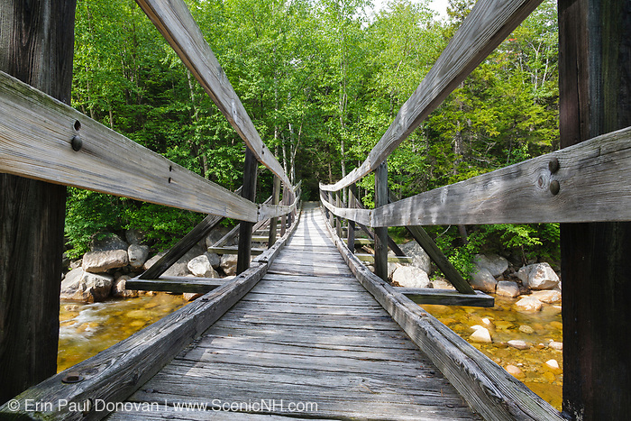 The decking on the footbridge along the Thoreau Falls Trail at North Fork Junction in Pemigewasset Wilderness of Lincoln, New Hampshire. This bridge crosses the East Branch of the Pemigewasset River, and it has a noticeable tilt.