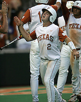 Texas 2B Travis Tucker celebrates scoring a run against Texas A&M on May 16th, 2008 in Austin Texas. Photo by Andrew Woolley / Four Seam Images..