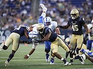 Annapolis, MD - October 7, 2017: Navy Midshipmen linebacker Brandon Jones (3) tackles Air Force Falcons quarterback Arion Worthman (2) during the game between Air Force and Navy at  Navy-Marine Corps Memorial Stadium in Annapolis, MD.   (Photo by Elliott Brown/Media Images International)