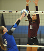 Amanda DeWitt #11 of Whitman, right, defends against a hit by Stephanie Gatto #6 of Centereach during a non-league varsity girls volleyball match at New York Institute of Technology in Old Westbury on Wednesday, Sept. 20, 2017. Whitman rallied from a two-set deficit to win 21-25, 16-25, 25-16, 25-22, 25-19.