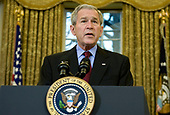 United States President George W. Bush discusses the Protect America Act in the Oval Office of the White House in Washington,, DC on February 13, 2008. <br /> Credit: Kristoffer Tripplaar / Pool via CNP