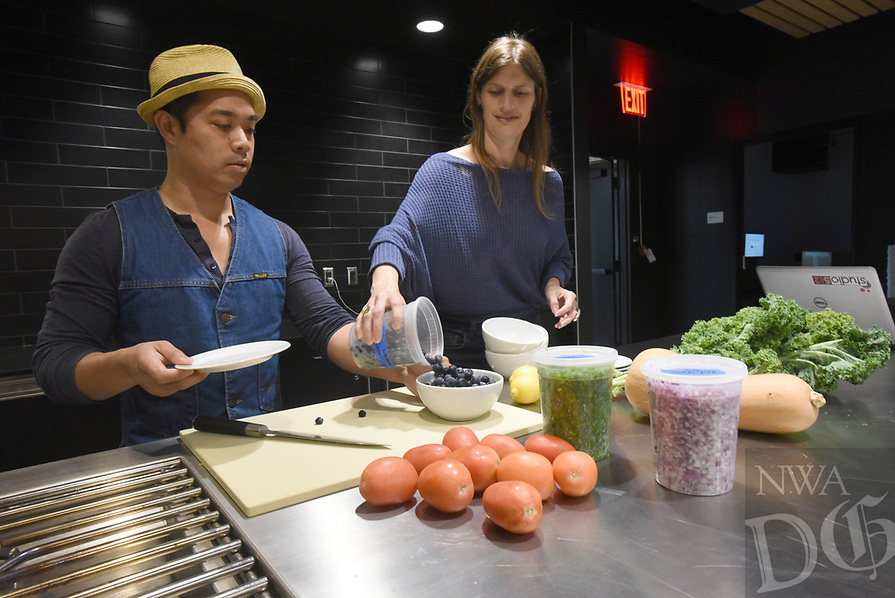 """NWA Democrat-Gazette/FLIP PUTTHOFF <br />Dream Kasestatad (left) and Nikki Bonner, both producers, prepare Tuesday May 2 2017 for the television show, """"Nosh Bite-Size Adventures"""" at Brightwater, A Center for the Study of Food, in Bentonville."""