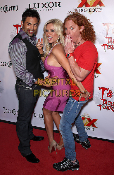 EDDIE JUDGE, TAMRA BARNEY & CARROT TOP (Scott Thompson).Tacos & Tequila kicks off  'Cougars & Cuervo' with Real Housewife Tamra Barney at Luxor Las Vegas, Las Vegas, Nevada, USA..April 6th, 2011.full length pink dress side boob looking over shoulder jeans denim blue shirt couple hand black trousers waistcoat red t-shirt funny.CAP/ADM/MJT.© MJT/AdMedia/Capital Pictures.