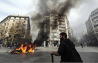 Pictured: A rubbish bin and other items are set alight by protesters  Friday 12 February 2016<br />Re: Violent clashes between farmers and riot police outside the Ministry of Agricultural Development in Athens, Greece. The farmers travelled from Crete to protest against pension and welfrae reforms proposed by the Greek government,