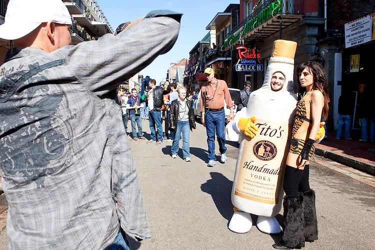 Revelers enjoy Bourbon Street during Mardi Gras in New Orleans on February 14, 2010.