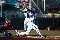 BT Riopelle (25) of the Coastal Carolina Chanticleers follows through on his swing against the Illinois Fighting Illini at Springs Brooks Stadium on February 22, 2020 in Conway, South Carolina. The Fighting Illini defeated the Chanticleers 5-2. (Brian Westerholt/Four Seam Images)