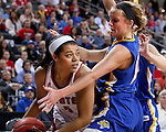 SIOUX FALLS, SD - MARCH 8:  Jasmine Trimboli #5 from the University of South Dakota looks for help as Kerri Young #10 from South Dakota State University applies pressure in the championship game of the 2016 Summit League Tournament Tuesday afternoon in Sioux Falls. (Photo by Dave Eggen/Inertia)