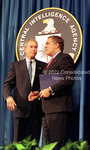 United States President George W. Bush is congratulated by CIA director George Tenet(R) after Bush spoke at the Central Intelligence Agency's headquarters in Langley, Virginia on September 26, 2001. U.S. Senate Intelligence Committee Vice Chairman Richard Shelby questioned the Tenet's competence in the wake of the September 11 attacks on New York and Washington. Bush voiced confidence in Tenet's abilities. 'I've got a lot of confidence in him and I've got a lot of confidence in the CIA. And so should America,' Bush told CIA employees, in his first visit to the spy agency's headquarters since the attacks. .Credit: Martin Simon / Pool via CNP