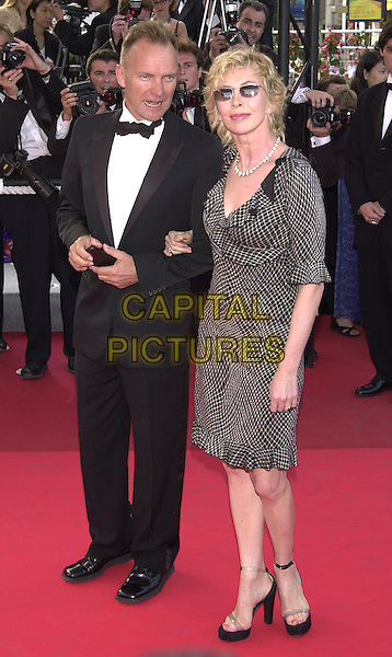 "STING & TRUDIE STYLER.At screening of Mike Leigh's ""All or Nothing"", Cannes Film Festival, France,.May 17th 2002..full length married husband wife trudi.Ref: PL.www.capitalpictures.com.sales@capitalpictures.com.©Capital Pictures."