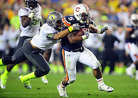 Jan 10, 2011; Glendale, AZ, USA;Auburn Tigers running back Michael Dyer (5) breaks away from Oregon Ducks safety Eddie Pleasant (11) during the fourth quarter of the 2011 BCS National Championship game at University of Phoenix Stadium.  Mandatory Credit: Mark J. Rebilas-