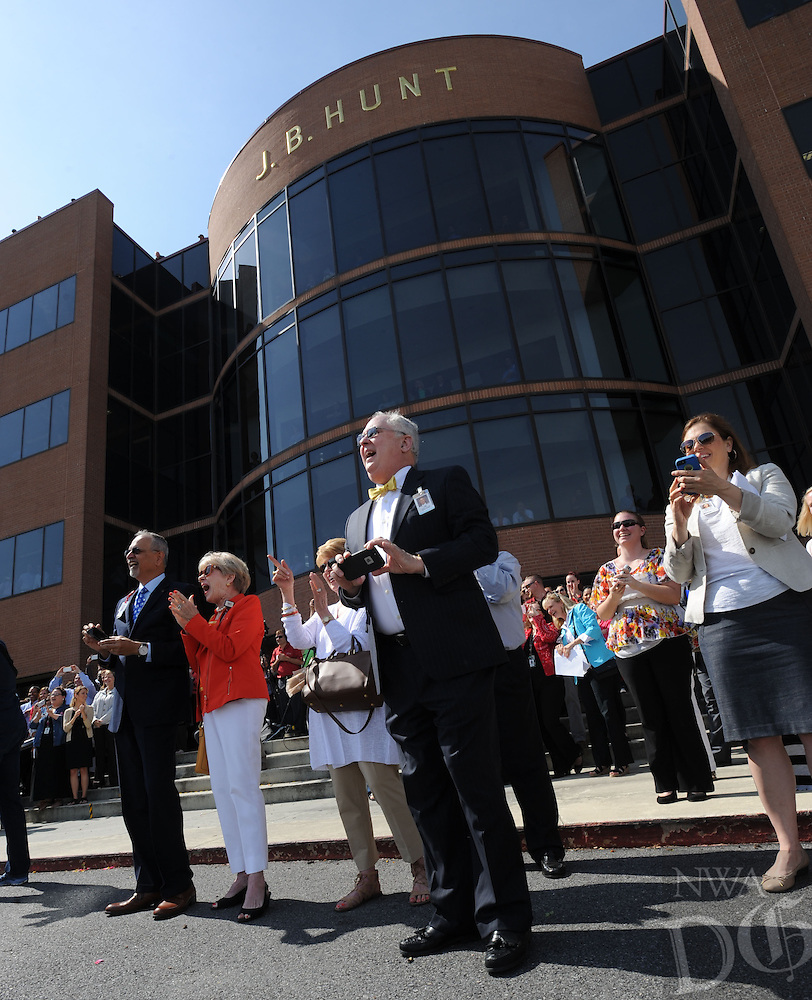 NWA Democrat-Gazette/ANDY SHUPE<br /> Jim McClelland (center), a member of the Arkansas Children's Hospital board of directors, laughs Thursday, May 19, 2016, during an announcement of a $5 million gift from J.B. Hunt Transport to Arkansas Children's Hospital for the construction of its planned Northwest Arkansas campus at the J.B. Hunt corporate offices in Lowell.