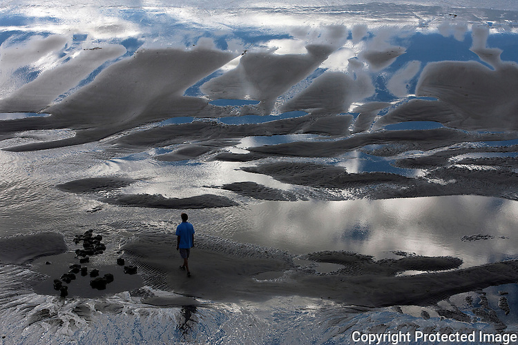 "Garett Kolonay, 17, checks out the extra-low tide in Leucadia, California in 2012. ""I was lookin' at the reflections of the sky in the tide pools,"" he said. ""Really cool.""  photo for U-T San Diego"
