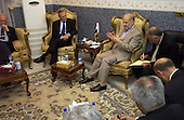 United States Secretary of Defense Donald H. Rumsfeld  (2nd from left) listens to Prime Minister Ibrahim Jafari of Iraq (3rd from left) during a meeting in his residence in Baghdad, Iraq, on April 12, 2005.   Rumsfeld is in Iraq to visit with United States and coalition forces and to meet with the newly elected members of the Iraqi government.  <br /> Mandatory Credit: Cherie A. Thurlby / U.S. Air Force via CNP