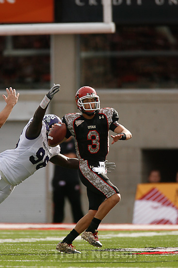 Trent Nelson  |  The Salt Lake Tribune.TCU's Wayne Daniels strips the ball from Utah quarterback Jordan Wynn during the first half, leading to a TCU touchdown. Utah vs. TCU college football, Saturday, November 6, 2010.
