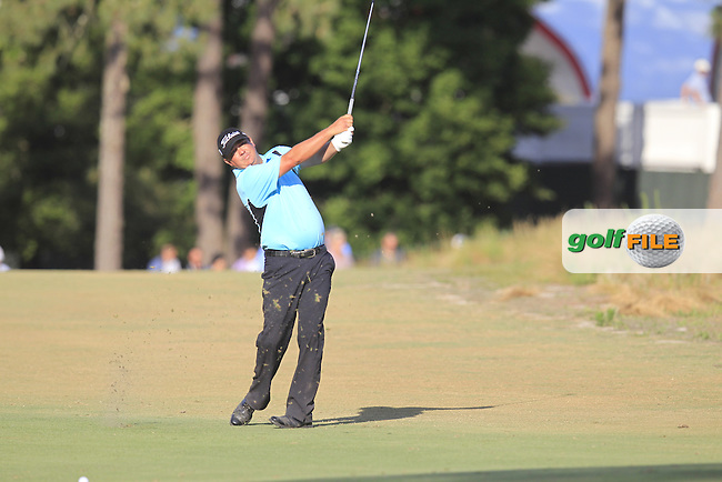 Jason Dufner (USA) plays his 2nd shot on the 18th hole during Thursday's Round 1 of the 2014 US Open Championship held at Pinehurst No.2 Course, Pinehurst, North Carolina, USA. 12th June 2014.<br /> Picture: Eoin Clarke www.golffile.ie