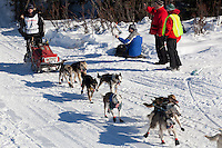 Musher Allen Moore on Long Lake at the Re-Start of the 2011 Iditarod Sled Dog Race in Willow, Alaska.