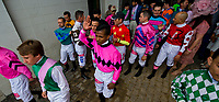 LOUISVILLE, KY - MAY 04: Jockeys funnel out of the tunnel to join in the Survivor's Parade as a show of support on Kentucky Oaks Day at Churchill Downs on May 4, 2018 in Louisville, Kentucky. (Photo by Scott Serio/Eclipse Sportswire/Getty Images)