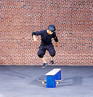 HORIZONTAL INERTIA: SKATEBOARDER JUMPS BARRIER (3 of 6)<br /> Newton's 1st Law: Moving at Constant Velocity<br /> The Skateboarder jumps straight up at the barrier.  Both boarder and board will continue to move with their original horizontal component of motion. After the barrier is passed, the boarder falls neatly back onto the board.