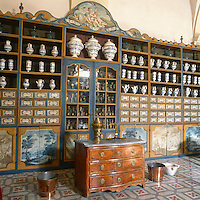 The Hotel-Dieu (general hospital) founded by Dom Malachie d'Inguimbert, who became the bishop of Carpentras, his hometown, in 1735. The architect was Antoine d'Allemand The pharmacy inside the Hôtel-Dieu. The jars and drawers below contain various medicinal products.