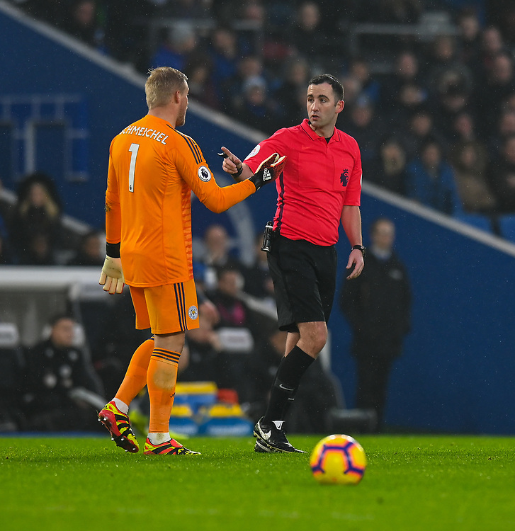 Leicester City's Kasper Schmeichel (left) and referee Christopher Kavanagh (right)  discussing run in with Brighton & Hove Albion's Pascal Gross <br /> <br /> Photographer David Horton/CameraSport<br /> <br /> The Premier League - Brighton and Hove Albion v Leicester City - Saturday 24th November 2018 - The Amex Stadium - Brighton<br /> <br /> World Copyright © 2018 CameraSport. All rights reserved. 43 Linden Ave. Countesthorpe. Leicester. England. LE8 5PG - Tel: +44 (0) 116 277 4147 - admin@camerasport.com - www.camerasport.com