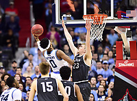 Washington, DC - MAR 11, 2018: Rhode Island Rams guard E.C. Matthews (0) goes up for a basket defended by Davidson Wildcats forward Peyton Aldridge (23) during the Atlantic 10 men's basketball championship between Davidson and Rhode Island at the Capital One Arena in Washington, DC. (Photo by Phil Peters/Media Images International)