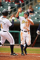 Montgomery Biscuits outfielder Johnny Field (1) high fives Richie Shaffer (8) after a home run during a game against the Jackson Generals on April 29, 2015 at Riverwalk Stadium in Montgomery, Alabama.  Jackson defeated Montgomery 4-3.  (Mike Janes/Four Seam Images)