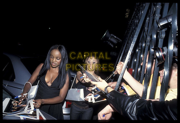 SUGABABES.16 September 2002.Ref: 11793.signing autographs, fans, half-length, half-length.*RAW SCAN- photo will be adjusted for publication*.www.capitalpictures.com.sales@capitalpictures.com.©Capital Pictures
