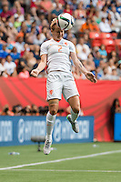 June 23, 2015: Desiree VAN LUNTEREN of Netherlands heads the ball during a round of 16 match between Japan and Netherlands at the FIFA Women's World Cup Canada 2015 at BC Place Stadium on 23 June 2015 in Vancouver, Canada. Japan won 2-1. Sydney Low/AsteriskImages.com