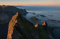 Last light illuminates mountain ridge over village of Reine, From Veinestind, Moskenesøy, Lofoten Islands, Norway