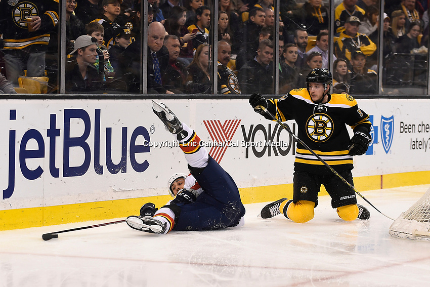 March 31, 2015 - Boston, Massachusetts, U.S. -  Florida Panthers center Vincent Trocheck (21) keeps control of the puck after colliding with Boston Bruins center Ryan Spooner (51) during the NHL match between the Florida Panthers and the Boston Bruins held at TD Garden in Boston Massachusetts. Eric Canha/CSM