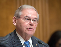 United States Senator Robert Menendez (Democrat of New Jersey), ranking member, makes a statement on the firing of US Secretary of State Rex Tillerson prior to  former Prime Minister David Cameron of the United Kingdom, Chairman, Commission on State Fragility, Growth and Development, giving testimony at a hearing before the US Senate Committee on Foreign Relations &quot;to examine state fragility, growth, and development, focusing on designing policy approaches that work&quot; on Capitol Hill in Washington, DC on Tuesday, March 13, 2018.<br /> Credit: Ron Sachs / CNP /MediaPunch