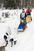 Eric Butcher Schuelle w/Iditarider on Trail 2005 Iditarod Ceremonial Start near Campbell Airstrip Alaska SC