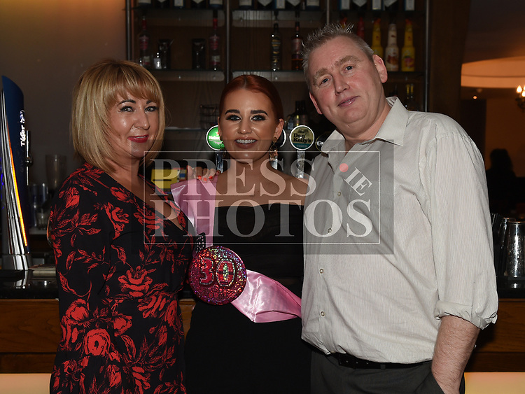 Karen Farrell celebrating her 30th birthday in Brú with parents John and Celine Rankin. Photo:Colin Bell/pressphotos.ie