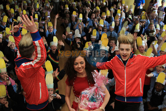 Presentation Primary School in Drogheda receive a visit from Jedward as the prize for collecting the most used mobile phones per student for the Jack and Jill Foundation. pictured here with teacher Audrey Lynch...(Photo credit should read Jenny Matthews www.newsfile.ie)....This Picture has been sent you under the conditions enclosed by:.Newsfile Ltd..The Studio,.Millmount Abbey,.Drogheda,.Co Meath..Ireland..Tel: +353(0)41-9871240.Fax: +353(0)41-9871260.GSM: +353(0)86-2500958.email: pictures@newsfile.ie.www.newsfile.ie.