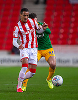 12th February 2020; Bet365 Stadium, Stoke, Staffordshire, England; English Championship Football, Stoke City versus Preston North End; Tom Ince of Stoke City is tackled by Jordan Storey of Preston North End - Strictly Editorial Use Only. No use with unauthorized audio, video, data, fixture lists, club/league logos or 'live' services. Online in-match use limited to 120 images, no video emulation. No use in betting, games or single club/league/player publications