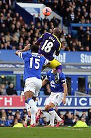 Pictured: Leroy Lita of Swansea (18) heads the ball over Sylvain Distin of Everton. Sunday 16 February 2014<br />