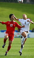 Hyon Mi Kim (PRK) and Vicki DiMartino (USA) compete for the ball..FIFA U17 Women's World Cup Final, USA v Korea DPR, Albany Stadium, Auckland, New Zealand, Sunday 16 November 2008. Photo: Renee McKay/PHOTOSPORT