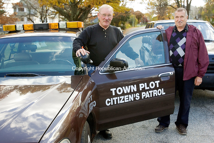 WATERBURY CT. 30 October 2014-103014SV09-From left, Bob Marti and Joe Savoy of Waterbury stand out with their vehicles at Chase Park in Waterbury Thursday.  Marti and Savoy are part of the Town Plot Citizens Patrol. <br /> Steven Valenti Republican-American