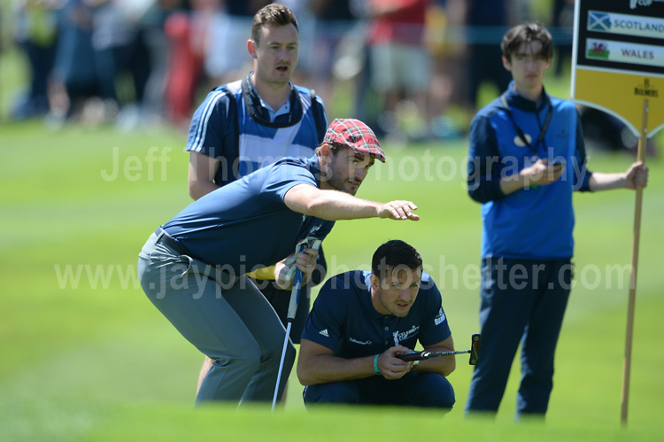 Former International rugby player Max Evans assists Olympic swimmer and fellow team member Michael Jamieson during The 2017 Celebrity Cup golf tournament at the Celtic Manor Resort, Newport, South Wales. 1.07.2017 <br /> <br /> <br /> Jeff Thomas Photography -  www.jaypics.photoshelter.com - <br /> e-mail swansea1001@hotmail.co.uk -<br /> Mob: 07837 386244 -